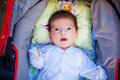 Adorable beautiful newborn baby looking up with a look of wonderment Stock Photos