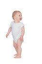 Adorable blond baby in underwear looking up isolated on a white background Royalty Free Stock Photography