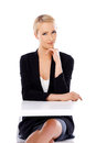 Adorable blond business woman sitting at desk Stock Photography