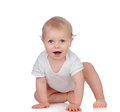 Adorable blonde baby in underwear crawling isolated on a white background Royalty Free Stock Image