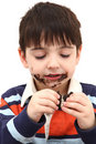 Adorable Boy Eating Cookies Royalty Free Stock Photography