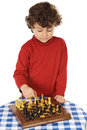 Adorable boy playing the chess Stock Photo