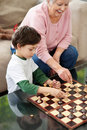Adorable boy playing chess with his grandmother Royalty Free Stock Photography