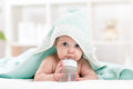 Adorable child baby drinking water from bottle Royalty Free Stock Photo