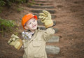 Adorable Child Boy with Big Gloves Playing Handyman Outside Royalty Free Stock Images