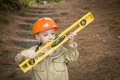 Adorable Child Boy with Level Playing Handyman Outside Royalty Free Stock Image