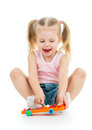 Adorable child girl playing with musical toy Royalty Free Stock Photo