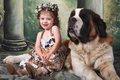 Adorable Child and Her Saint Bernard Puppy Dog Stock Image