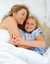 Adorable child hugging with her mother Stock Image