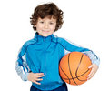 Adorable child playing the basketball Stock Photos