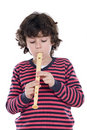 Adorable child playing flute Royalty Free Stock Photo