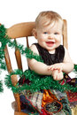Adorable Christmas baby rocks in patchwork dress Royalty Free Stock Photos
