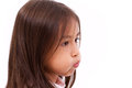 Adorable cute little girl pucker her mouth Royalty Free Stock Photo