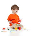 Adorable dirty child with paints Stock Images