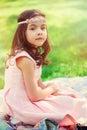 Adorable dressy child girl in spring garden dreamy Stock Photos