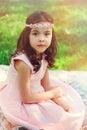 Adorable dressy child girl in spring garden dreamy Stock Photo