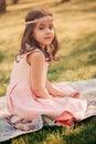 Adorable dressy child girl in spring garden dreamy Stock Image