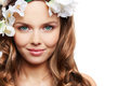 Adorable face head shot of an female model with hair decorated with flowers Stock Photography