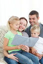Adorable family reading a book together Royalty Free Stock Photos