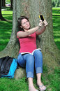 Adorable female student - taking photo of self Stock Photo