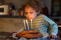 Adorable four year old boy celebrating his birthday and blowing candles Royalty Free Stock Photos