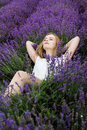 Adorable girl in fairy field of lavender carefree summer freedom enjoy concept Stock Photo