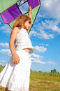 Adorable girl flying a kite Stock Images