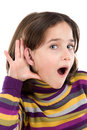 Adorable girl hearing Stock Image