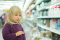 Adorable girl in milk department in supermarket Stock Photography