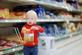 Adorable girl shopping toddler went Stock Images