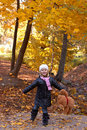 Adorable girl with teddy bear outdoors on beautiful autumn day Stock Photos