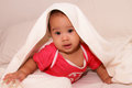Adorable infant at nursery asian baby girl with towel on her head child Stock Photos