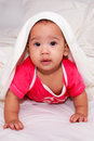 Adorable infant with towel on her head asian baby girl at child nursery Stock Photo