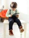 Adorable kid cute with tablet Royalty Free Stock Photography