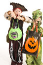 Adorable kids playing trick or treat Royalty Free Stock Image