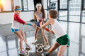 Adorable kids in sportswear training with ropes at fitness studio Royalty Free Stock Photo