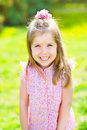 Adorable laughing little girl with long blond hair outdoor portrait in summer park Stock Photo