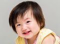 Adorable little baby girl smile with gray background Royalty Free Stock Photo