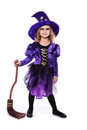 Adorable little blond girl wearing a witch costume smiling at the camera. Halloween. Fairy. Tale. Studio portrait isolated Royalty Free Stock Photo