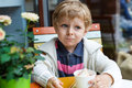 Adorable little boy eating frozen yoghurt ice cream in cafe city Stock Photos
