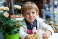 Adorable little boy eating frozen yoghurt ice cream in cafe city Royalty Free Stock Photos