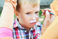 Adorable little boy getting her face painted. Children painted Royalty Free Stock Photo