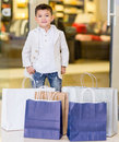 Adorable little boy very happy his shopping bags Royalty Free Stock Image