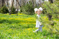 Adorable little child girl on grass on meadow. Summer green nature background. Royalty Free Stock Photo