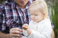 Adorable Little Girl Eating a Cookie with Daddy Royalty Free Stock Photo