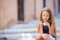 Adorable little girl eating ice-cream outdoors at summer. Cute kid enjoying real italian gelato in Rome Royalty Free Stock Photo