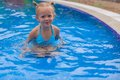 Adorable little girl enjoy in the swimming pool this image has attached release Royalty Free Stock Photos