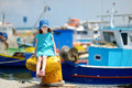 Adorable little girl at fisherman village in greece Royalty Free Stock Images