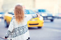 Adorable little girl get taxi outdoors in European Royalty Free Stock Photo