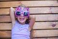Adorable little girl in happy birthday glasses have fun outdoor this image has attached release Royalty Free Stock Photos